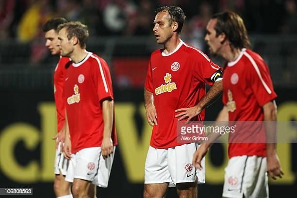 Adam Szalai, Bo Svensson, Nikolce Noveski and Christian Fuchs of Mainz react during the Bundesliga match between FSV Mainz 05 and Hannover 96 at the...