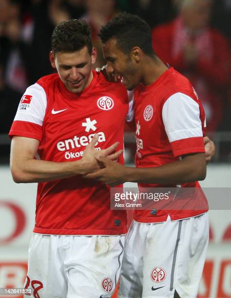 Adam Szalai celebrates his team's fourth goal with team mate Eric Maxim ChoupoMoting during the Bundesliga match between between FSV Mainz 05 and 1...