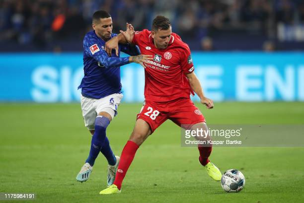 Adam Szalai of 1 FSV Mainz 05 holds off Omar Mascarell of FC Schalke 04 during the Bundesliga match between FC Schalke 04 and 1 FSV Mainz 05 at...