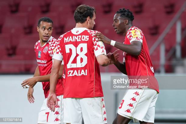 Adam Szalai of 1.FSV Mainz 05 celebrates after scoring his team`s second goal with team mates Robin Quaison of 1.FSV Mainz 05 and Jean-Philippe...