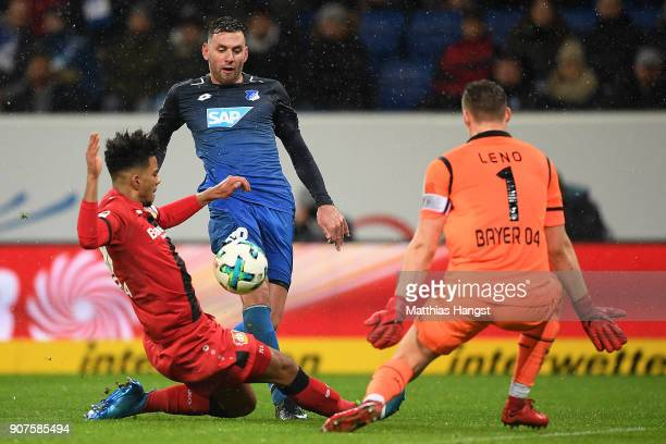 Adam Szalai of Hoffenheim about to score a goal past goalkeeper Bernd Leno of Bayer Leverkusen and Benjamin Henrichs of Bayer Leverkusen during the...