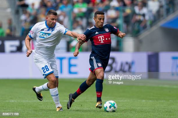 Adam Szalai of Hoffenheim and Thiago of Munich battle for the ball during the Telekom Cup 2017 match between Bayern Muenchen and 1899 Hoffenheim at...