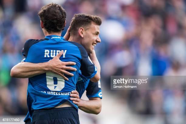 Adam Szalai of Hoffenheim celebrates his team's first goal with team mate Sebastian Rudy during the Bundesliga match between TSG 1899 Hoffenheim and...