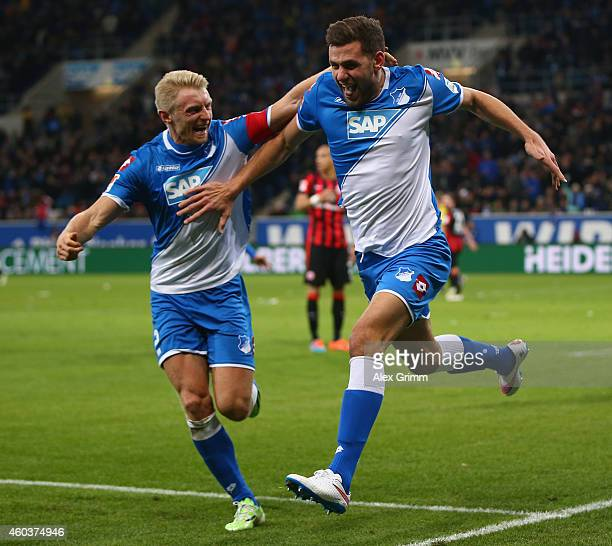 Adam Szalai of Hoffenheim celebrates scoring his team's second goal with Andreas Beck during the Bundesliga match between 1899 Hoffenheim and...