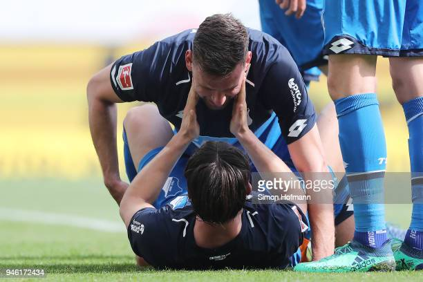 Adam Szalai of Hoffenheim celebrates with Nico Schulz of Hoffenheim after he scored a goal to make it 20 during the Bundesliga match between TSG 1899...