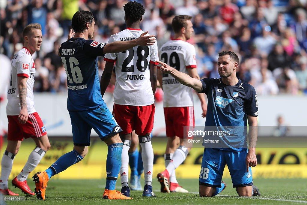 Adam Szalai of Hoffenheim (right) celebrates with Nico Schulz of Hoffenheim (16, left) after he scored a goal to make it 2:0 during the Bundesliga match between TSG 1899 Hoffenheim and Hamburger SV at Wirsol Rhein-Neckar-Arena on April 14, 2018 in Sinsheim, Germany.