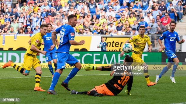 Adam Szalai of Hoffenheim scores the second goal for his team against Roman Buerki of Dortmund during the Bundesliga match between TSG 1899...