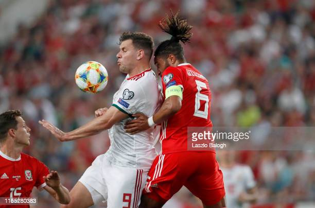 Adam Szalai of Hungary and Ashley Williams of Wales compete for the ball during the UEFA Euro 2020 Qualifier between Hungary and Wales at Groupama...