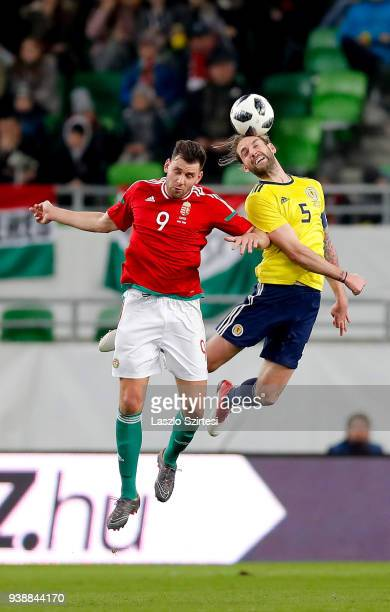 Adam Szalai of Hungary and Charlie Mulgrew of Scotland in action during the International Friendly match between Hungary and Scotland at Groupama...