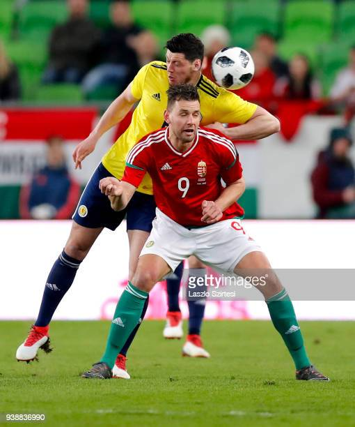 Adam Szalai of Hungary and Scott McKenna of Scotland in action during the International Friendly match between Hungary and Scotland at Groupama Arena...