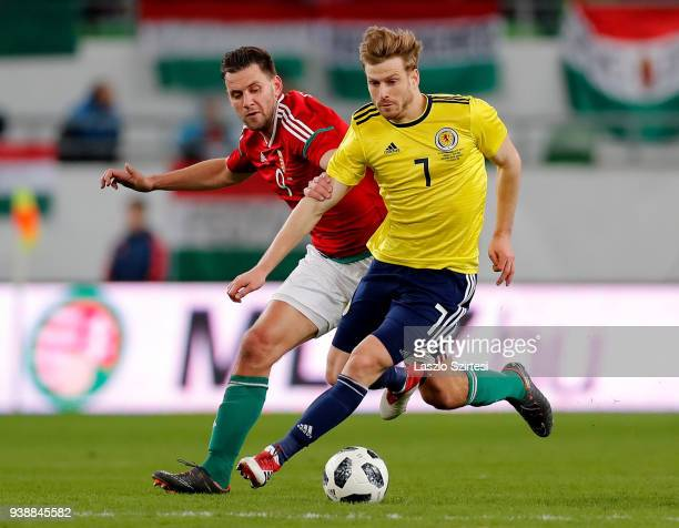 Adam Szalai of Hungary and Stuart Armstrong of Scotland in action during the International Friendly match between Hungary and Scotland at Groupama...