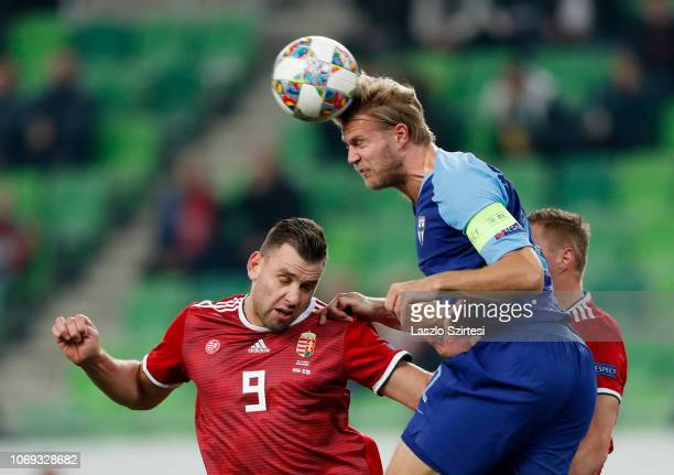 Adam Szalai of Hungary battles for the ball in the air with Paulus Arajuuri of Finland in front of Willi Orban of Hungary during the UEFA Nations...