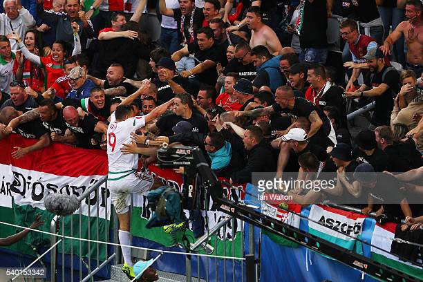 Adam Szalai of Hungary celebrates scoring his team's first goal with supporters during the UEFA EURO 2016 Group F match between Austria and Hungary...