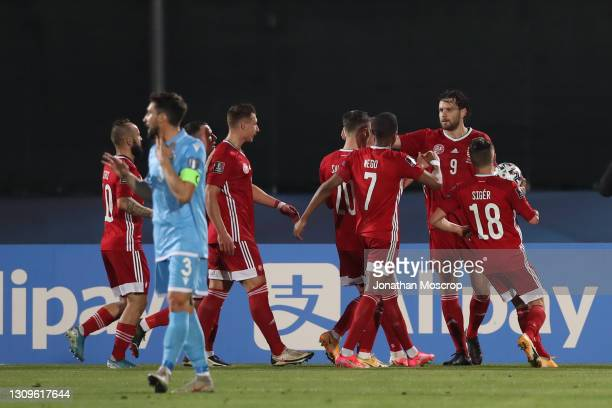 Adam Szalai of Hungary celebrates with team mates after scoring a first half penalty to give the side a 1-0 lead during the FIFA World Cup 2022 Qatar...