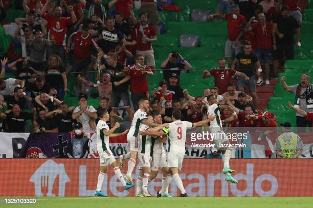 Adam Szalai of Hungary celebrates with team mates after scoring their side's first goal during the UEFA Euro 2020 Championship Group F match between...