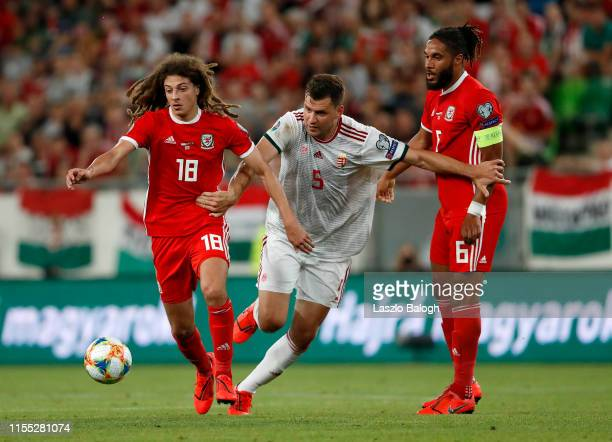 Adam Szalai of Hungary competes for the ball with Ethan Ampadu as Ashley Williams of Wales looks on during the UEFA Euro 2020 Qualifier between...