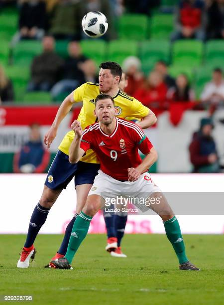 Adam Szalai of Hungary competes for the ball with Scott McKenna of Scotland during the International Friendly match between Hungary and Scotland at...