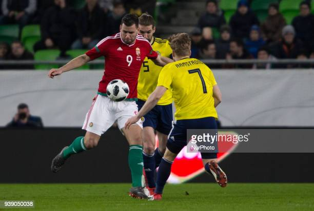 Adam Szalai of Hungary competes for the ball with Stuart Armstrong of Scotland during the friendly match between Hungary and Scotland at Groupama...