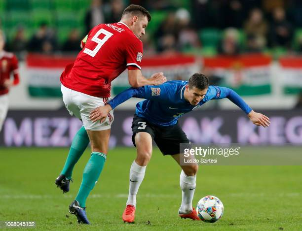 Adam Szalai of Hungary fights for the ball with Artur Pikk of Estonia during the UEFA Nations League group stage match between Hungary and Estonia at...