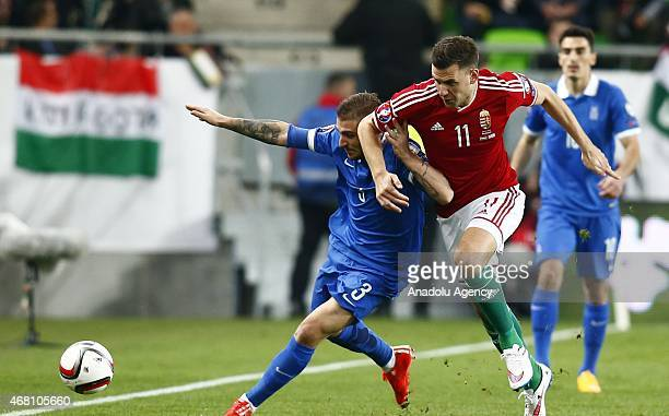 Adam Szalai of Hungary is challenged by Kostas Stafylidis of Greece during Hungary v Greece European Euro 2016 qualification soccer match at Grupama...