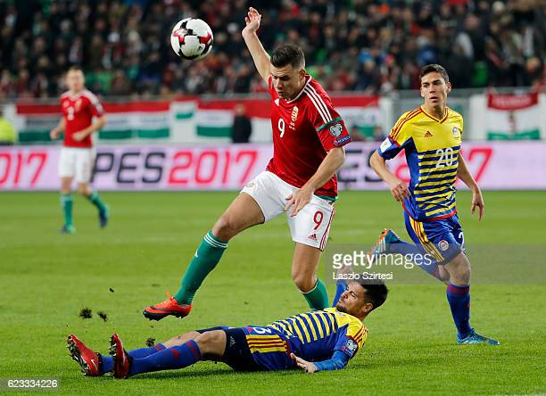 Adam Szalai of Hungary is tackled by Marc Vales of Andorranext tof Max Llovera od Andorra during the FIFA 2018 World Cup Qualifier match between...