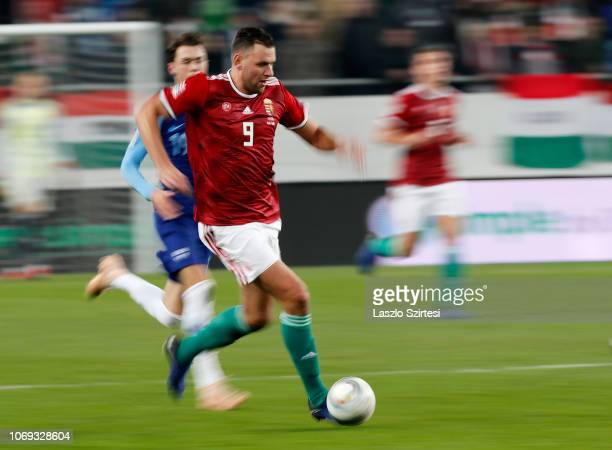 Adam Szalai of Hungary leaves Thomas Lam of Finland behind during the UEFA Nations League group stage match between Hungary and Finland at Groupama...