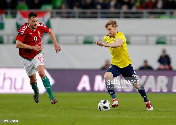 Adam Szalai of Hungary tries to reach Stuart Armstrong of Scotland during the International Friendly match between Hungary and Scotland at Groupama...
