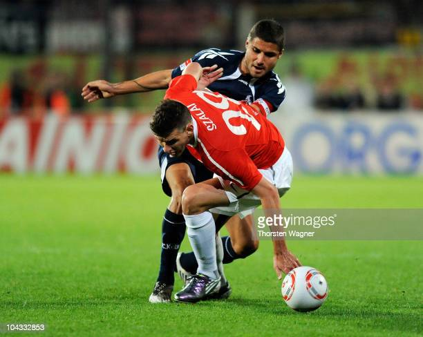 Adam Szalai of Mainz battles for the ball with Youssef Mohamad of Koeln during the Bundesliga match between FSV Mainz 05 and 1.FC Koeln at Bruchweg...
