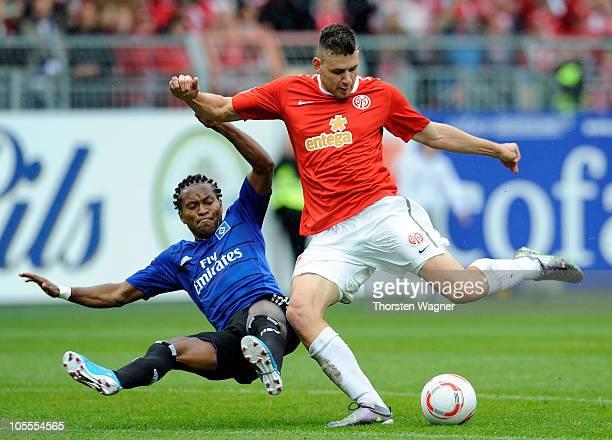 Adam Szalai of Mainz battles for the ball with Ze Roberto of Hamburg during the Bundesliga match between FSV Mainz 05 and Hamburger SV at Bruchweg...