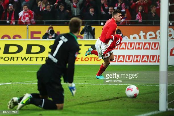 Adam Szalai of Mainz celebrates his team's second goal as goalkeeper RonRobert Zieler of Hannover reacts during the Bundesliga match between 1 FSV...