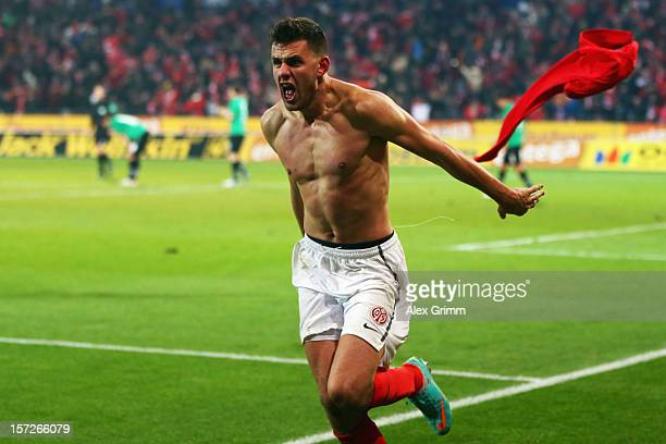 Adam Szalai of Mainz celebrates his team's second goal during the Bundesliga match between 1 FSV Mainz 05 and Hannover 96 at Coface Arena on December...
