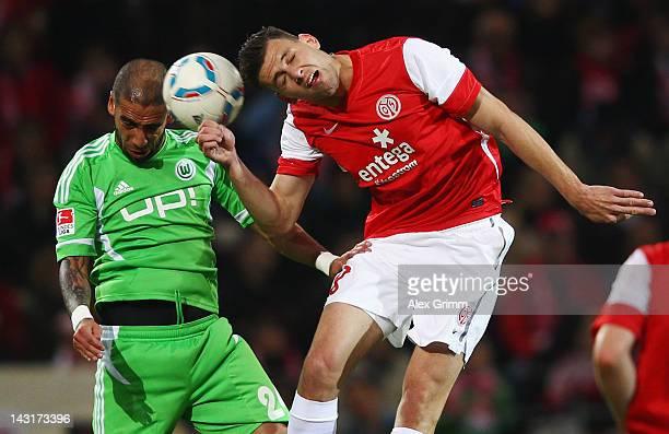 Adam Szalai of Mainz is challenged by Ashkan Dejagah of Wolfsburg during the Bundesliga match between FSV Mainz 05 and VfL Wolfsburg at Coface Arena...