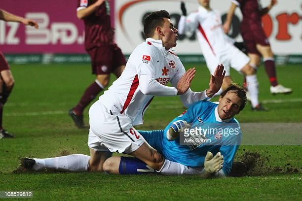 Adam Szalai of Mainz is challenged by goalkeeper Tobias Sippel of Kaiserslautern during the Bundesliga match between 1 FC Kaiserslautern and FSV...