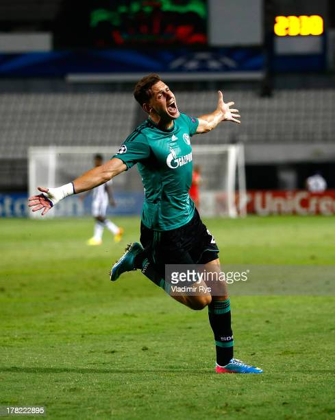 Adam Szalai of Schalke celebrates after scoring his team's third goal during the UEFA Champions League second leg play-off match between PAOK...