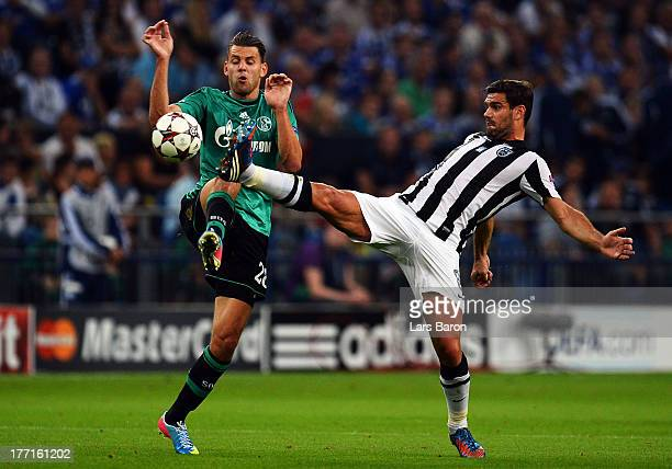 Adam Szalai of Schalke is challenged by Alexandros Tziolis of Saloniki during the UEFA Champions League Play-off first leg match between FC Schalke...