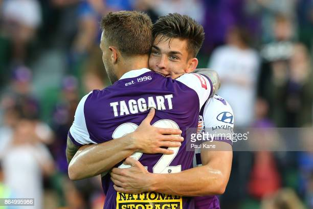 Adam Taggart and Brandon Wilson of the Glory celebrate a goal during the round three ALeague match between Perth Glory and the Central Coast Mariners...