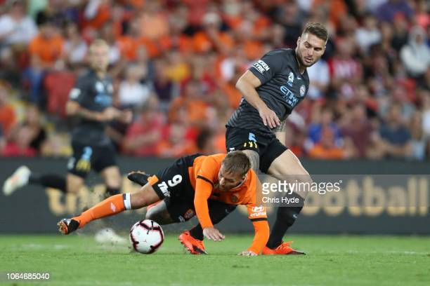 Adam Taggart of Roar and Bart Schenkeveld of City FC compete for the ball during the round five ALeague match between the Brisbane Roar and Melbourne...