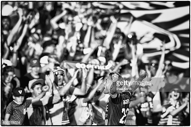Adam Taggart of the Glory celebrates with supporters after scoring a goal during the round 16 ALeague match between Perth Glory and Melbourne Victory...