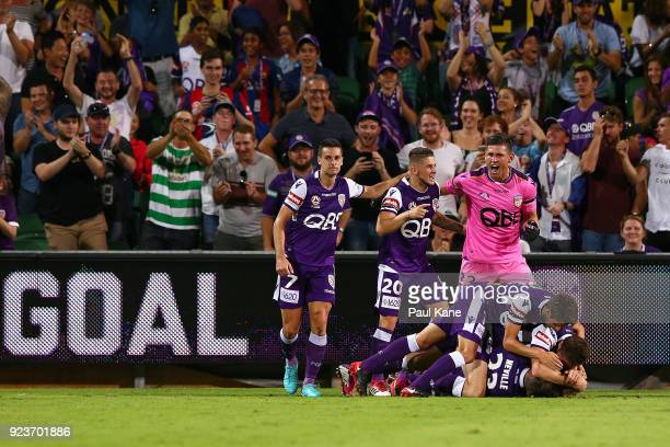 Adam Taggart of the Glory is congratulated by team mates after scoring the winning goal during the round 21 ALeague match between the Perth Glory and...