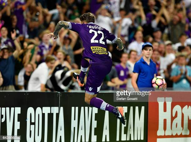 Adam Taggart of the Glory jumps the boundry fence during the round 20 ALeague match between Perth Glory and Brisbane Roar at nib Stadium on February...