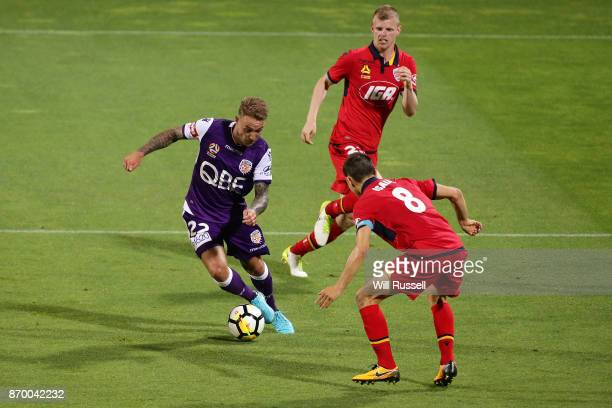 Adam Taggart of the Glory looks for a way through the defence during the round five ALeague match between the Perth Glory and Adelaide United at nib...
