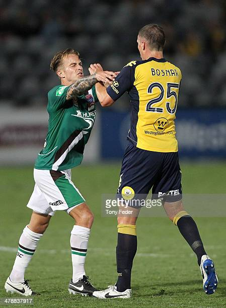 Adam Taggart of the Jets and Eddy Bosnar of the Mariners push one another during the round 23 ALeague match between the Central Coast Mariners and...