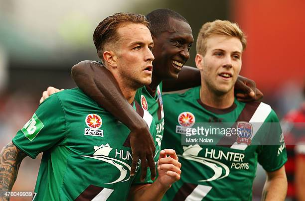 Adam Taggart of the Jets celebrates scoring a goal with team mates Emile Heskey and Andrew Hoole during the round 21 ALeague match between the...