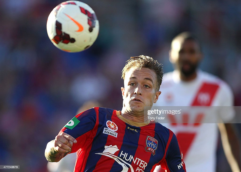 Adam Taggart of the Jets chases the ball during the round 22 A-League match between the Newcastle Jets and Melbourne Heart at Hunter Stadium on March 8, 2014 in Newcastle, Australia.