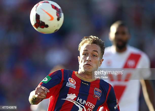Adam Taggart of the Jets chases the ball during the round 22 ALeague match between the Newcastle Jets and Melbourne Heart at Hunter Stadium on March...