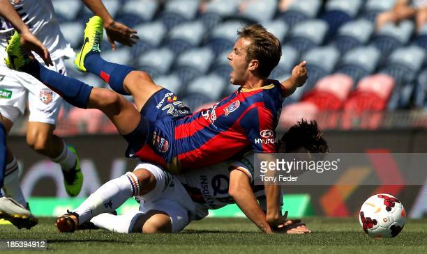 Adam Taggart of the Jets collides with Joshua Risdon of the Glory during the round two A-League match between the Newcastle Jets and the Perth Glory...