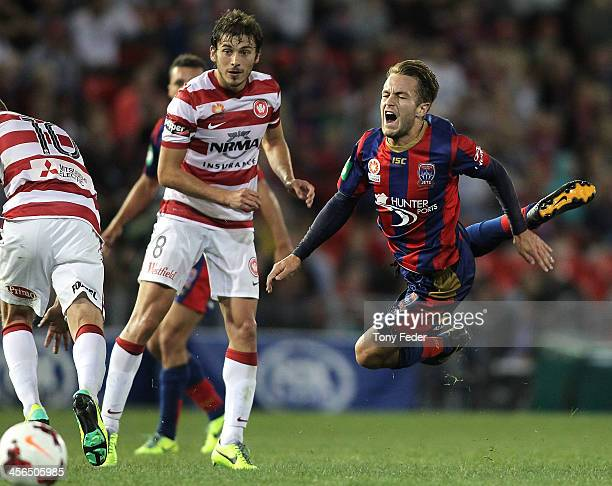 Adam Taggart of the Jets flies through the air during the round 10 A-League match between the Newcastle Jets and the Western Sydney Wanderers at...