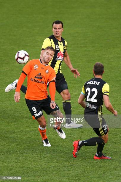 Adam Taggart of the Roar heads the ball under pressure from Steven Taylor and Andrew Durante of the Phoenix during the round nine ALeague match...