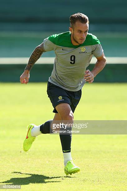 Adam Taggart of the Socceroos sprints during an Australian Socceroos training session and press conference at Estadio Couto Pereira on June 22 2014...