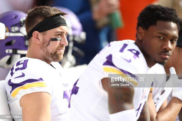 Adam Thielen and Stefon Diggs of the Minnesota Vikings look on from the sideline during the first half against the Kansas City Chiefs at Arrowhead...